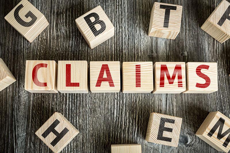 claims written on wooden blocks